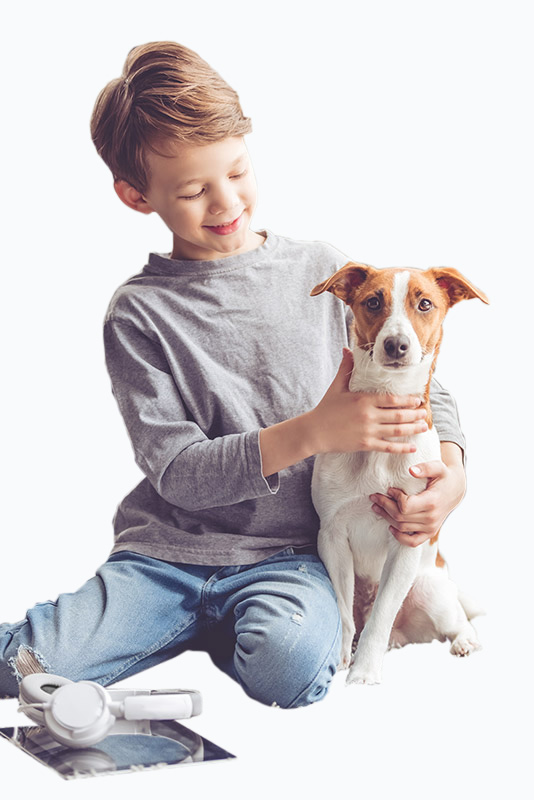 Young lad giving his pet dog a cuddle